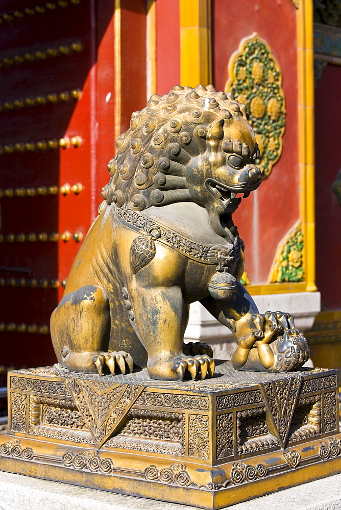 Gilded female lion statue with lion cub under paw in the Forbidden City, Beijing, China