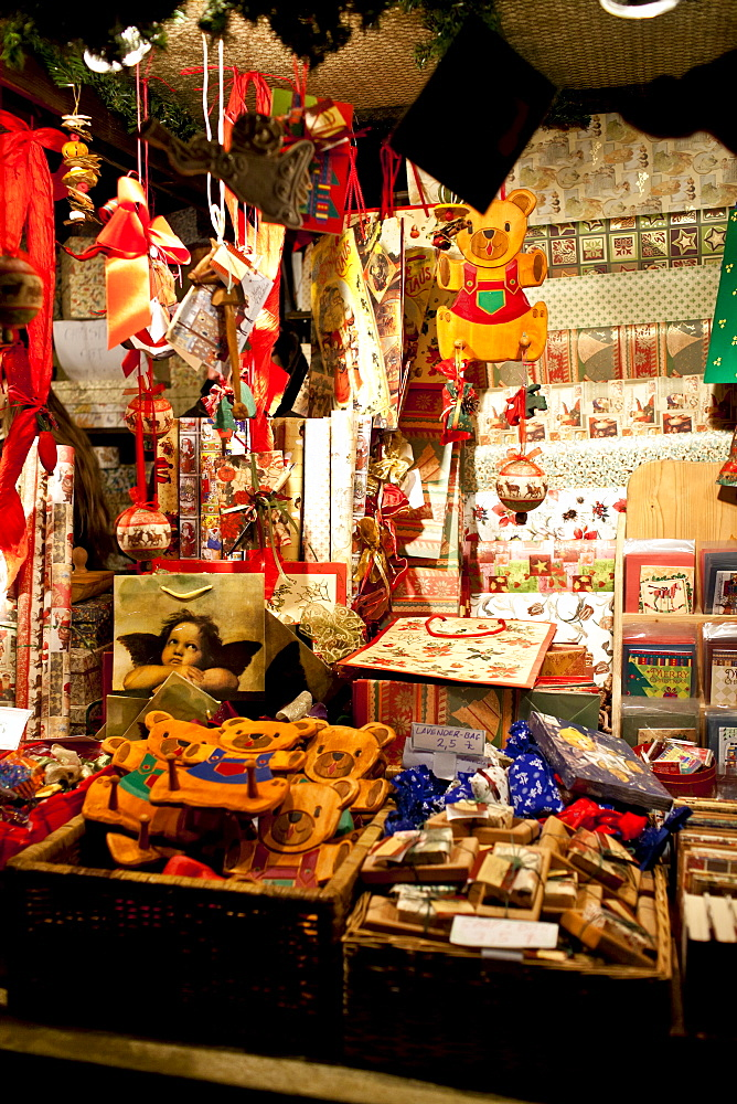 Christmas ornaments and wrapping paper at traditional stall at Christmas market, Winter Wonderland, Hyde Park, London