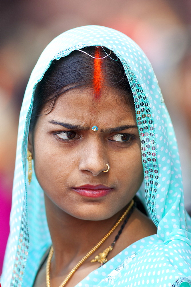 Hindu pilgrim with bindi mark at Vishwanatha Temple (Birla Temple) during Festival of Shivaratri in holy city of Varanasi, India