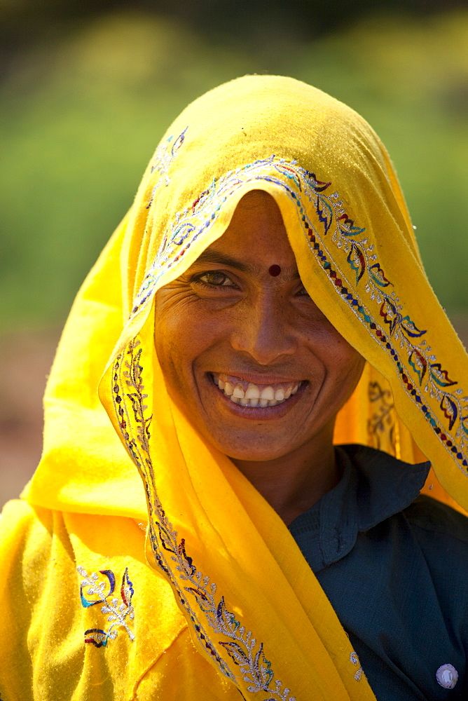 Indian woman villager at farm smallholding at Sawai Madhopur near Ranthambore in Rajasthan, Northern India