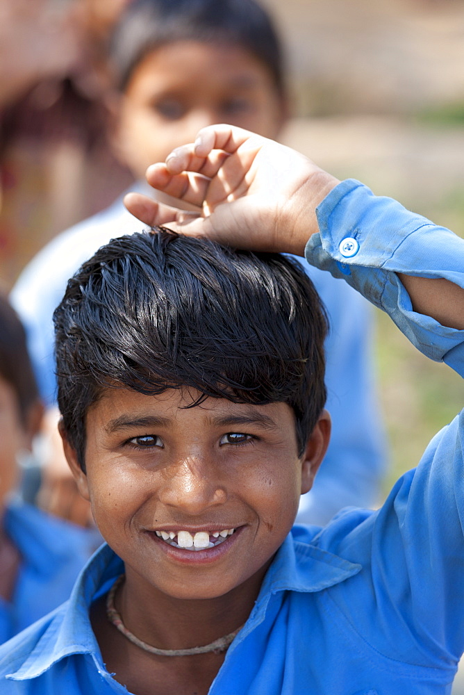 Indian schoolboy attending school at Doeli in Sawai Madhopur, Rajasthan, Northern India