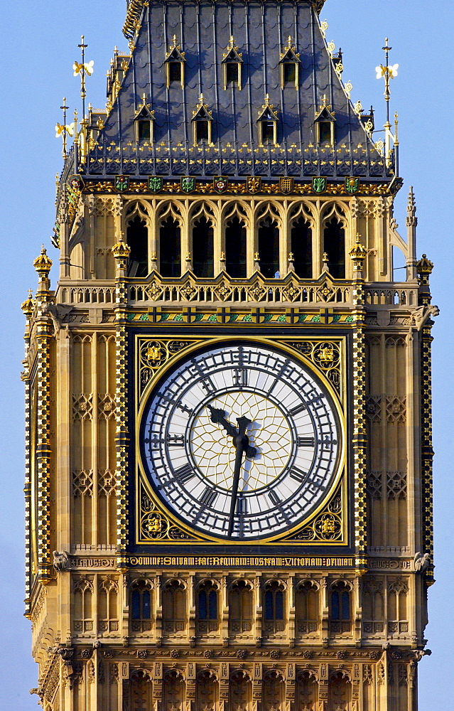 St Stephen's Tower on the Houses of the Parliament which houses Big Ben, the famous clock bells. The great clock of Westminster shows a time of ten thirty (half past ten).