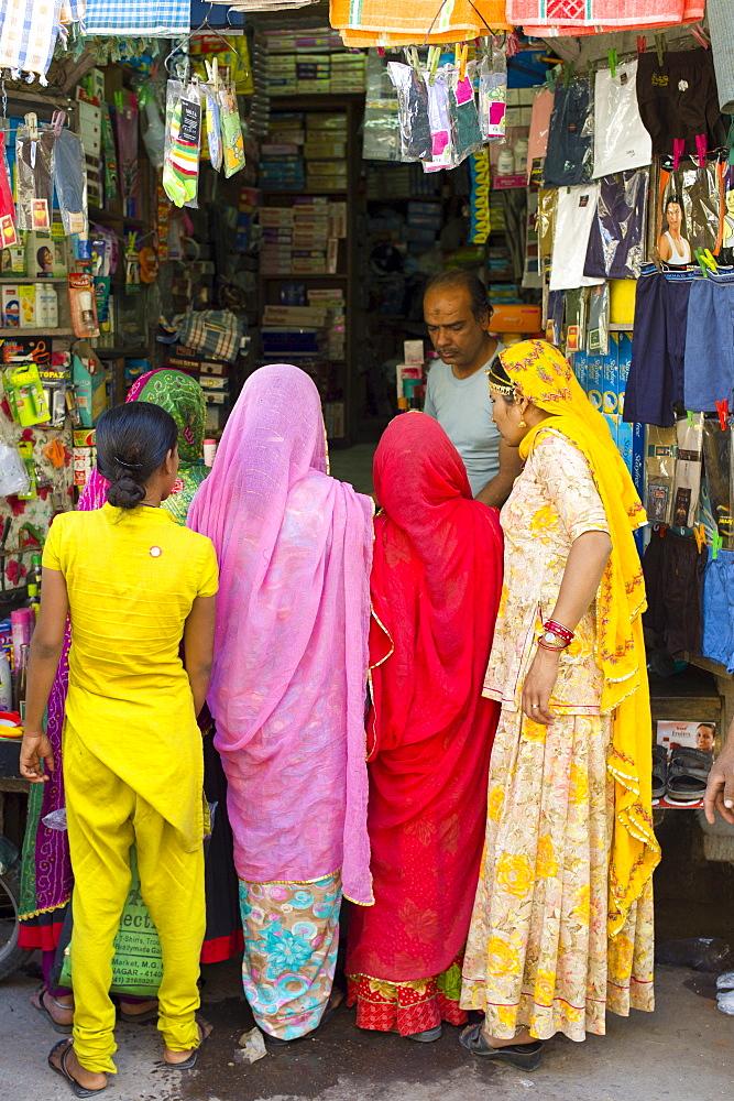 Indian women shopping, street scene at Tambaku Bazar in Jodhpur Old Town, Rajasthan, Northern India