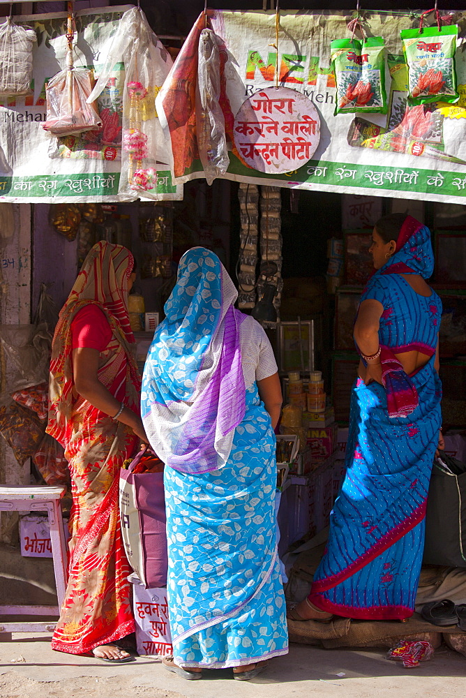 Indian women shopping, street sceneTambaku Bazar in Jodhpur Old Town, Rajasthan, Northern India