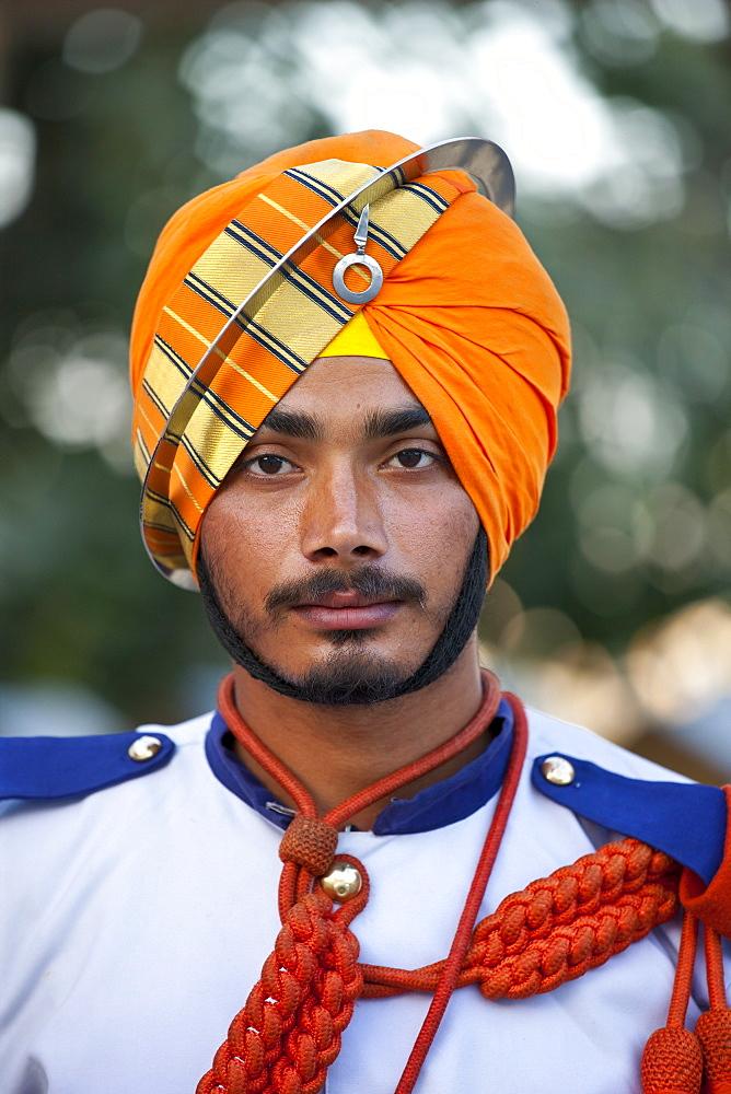 Military musician of 76th Maharana of Mewar, His Highness, Shriji Arvind Singh Mewar of Udaipur, at the City Palace, Rajasthan, India