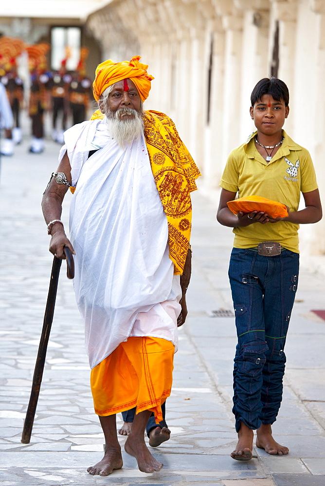 Hindu priest at Holi festival of 76th Maharana of Mewar, His Highness, Shriji Arvind Singh Mewar of Udaipur, at the City Palace, Rajasthan, India