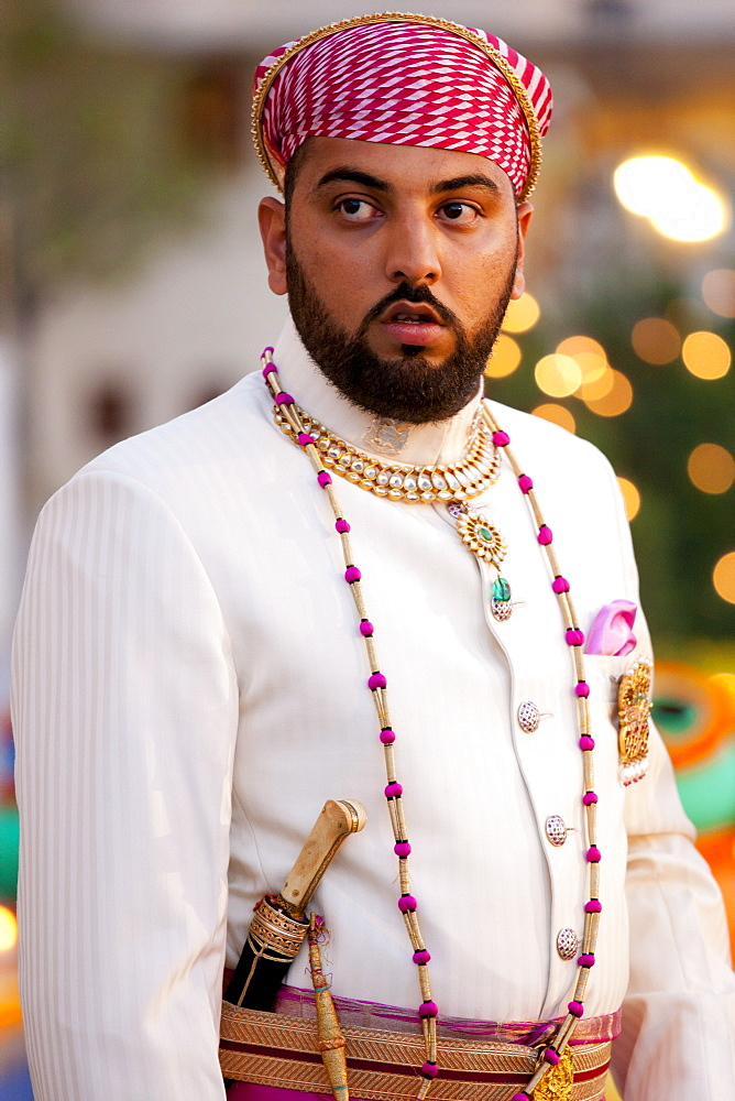 Lakshaya Raj, son and heir of 76th Maharana of Mewar, Shriji Arvind Singh Mewar of Udaipur, at Holi Festival at the City Palace, Rajasthan, India