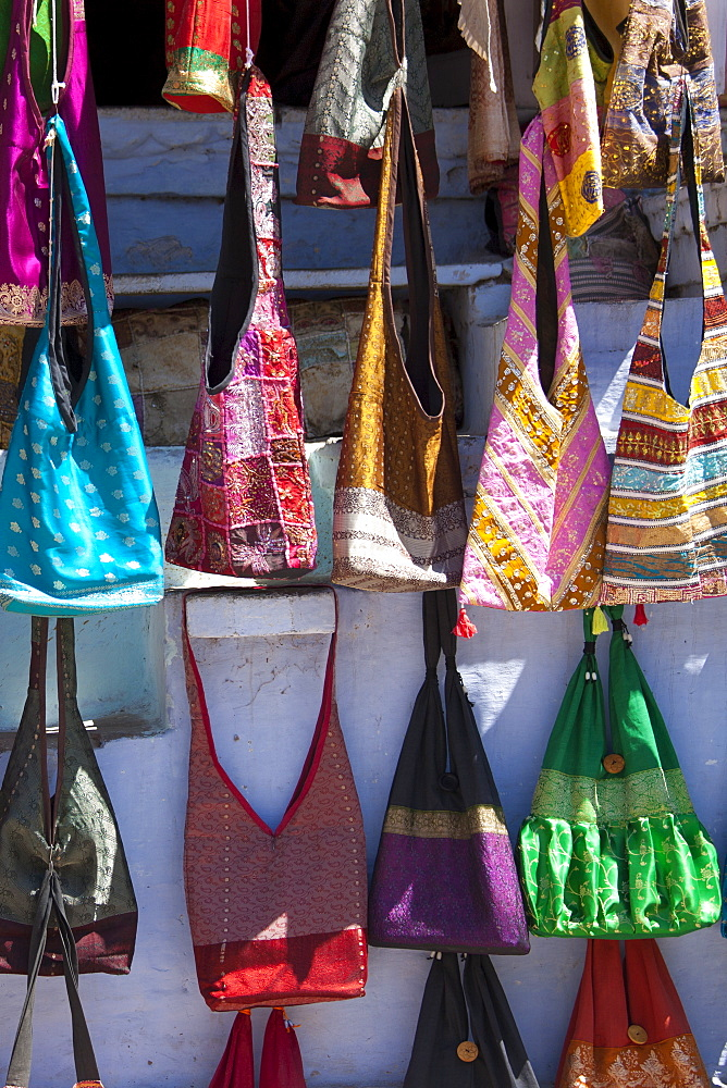 Woven fabric handbags on sale in street market in City Palace Road, Udaipur, Rajasthan, Western India