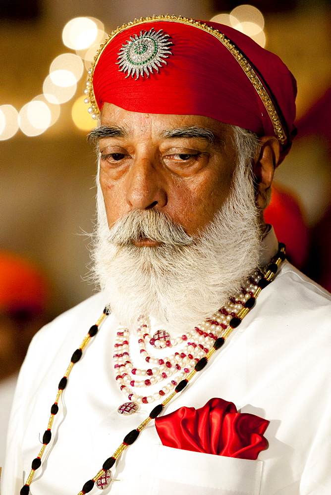 Shriji Arvind Singh Mewar of Udaipur, 76th Custodian of the House of Mewar, presides at annual Hindu Holi Fire Festival at The Zenana Mahal in the City Palace, Udaipur, Rajasthan, India