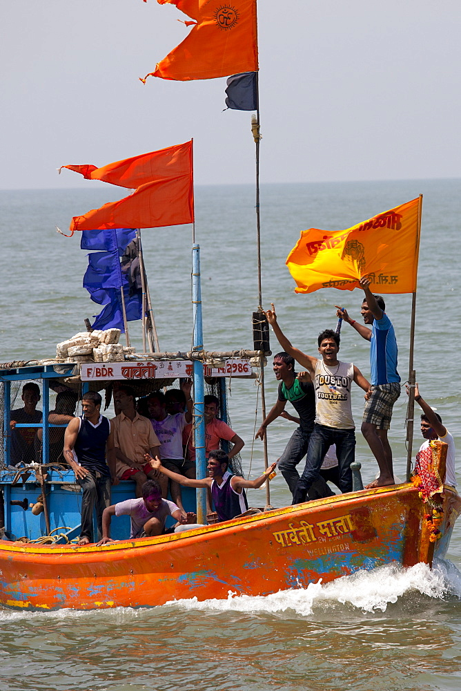 Young Indian men on boat trip celebrating Hindu Holi festival of colours at Nariman Point, Mumbai, formerly Bombay, India - 1161-5280