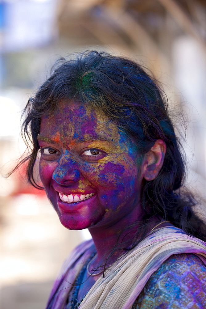 Indian woman celebrating annual Hindu Holi festival of colours with powder paints in Mumbai, formerly Bombay, Maharashtra, India