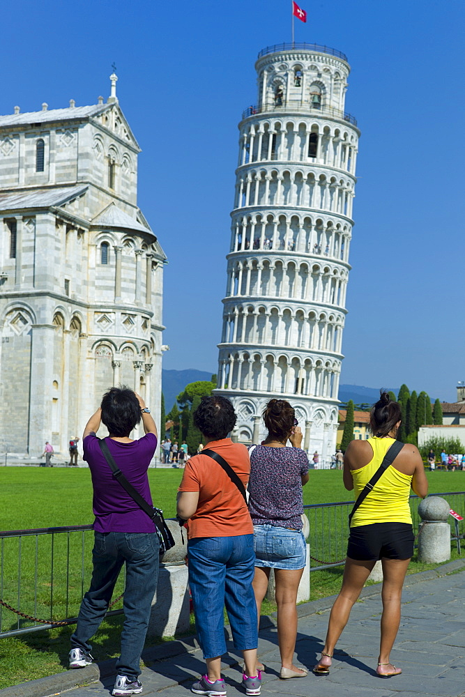 Tourists photographThe Leaning Tower of Pisa, Torre pendente di Pisa, campanile bell tower and Cathedral of Santa Maria, Pisa, Italy
