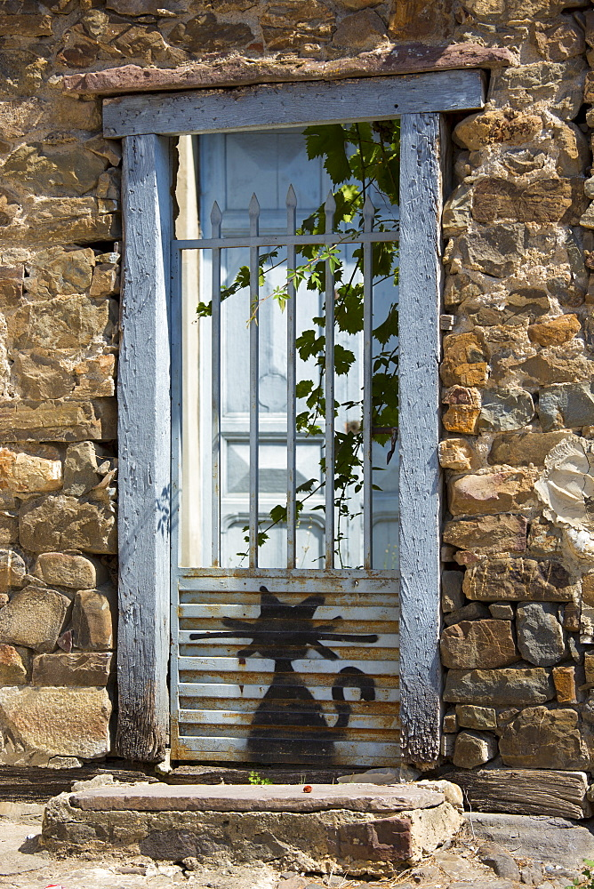 Cat drawn on gate at Potes in Picos de Europa, Asturias, Northern Spain