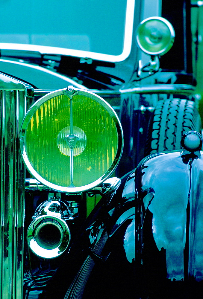 Detail showing lamps and horns of a Rolls Royce motor car which has been carefully restored as a classic car, Gloucestershire, United Kingdom