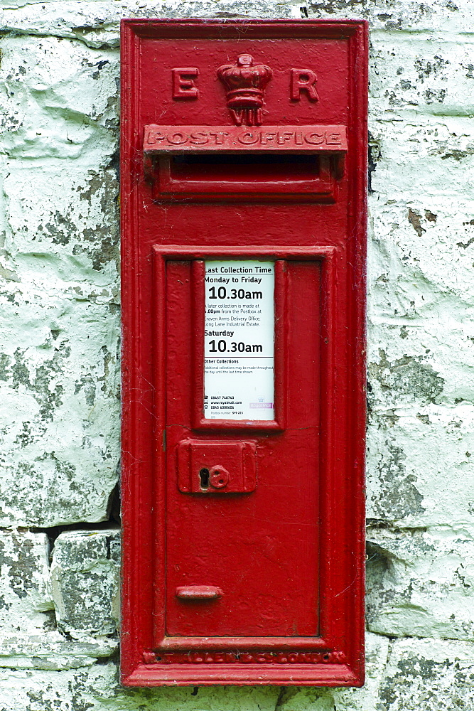 Wall mounted postbox with E R Elizabeth Regina cypher in Anchor, Shropshire, United Kingdom