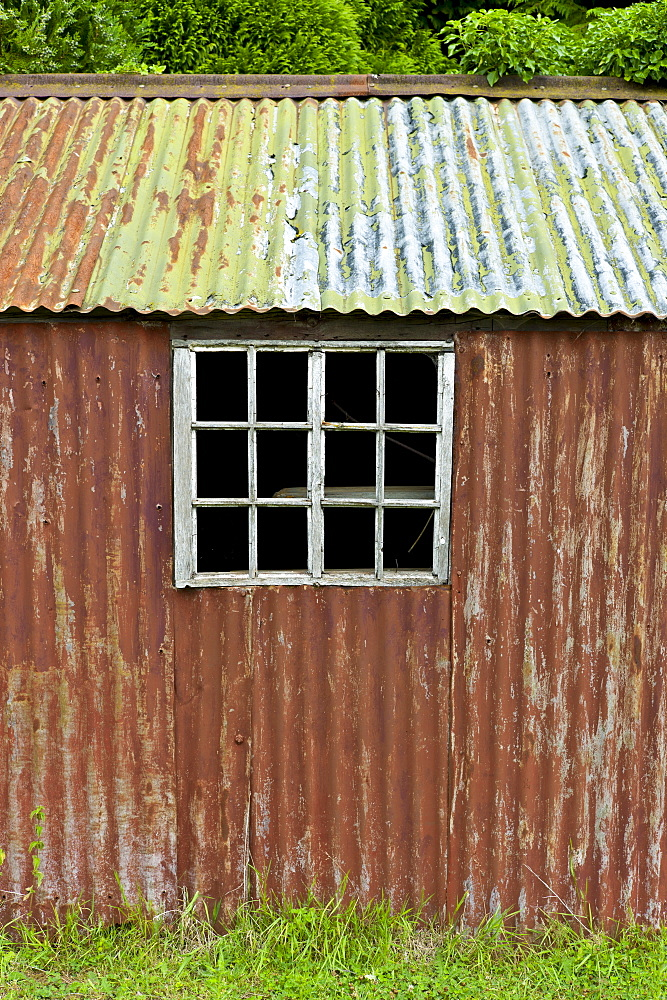 Rusty corrugated iron shed in the Cotswolds village of Bledington, Oxfordshire, UK