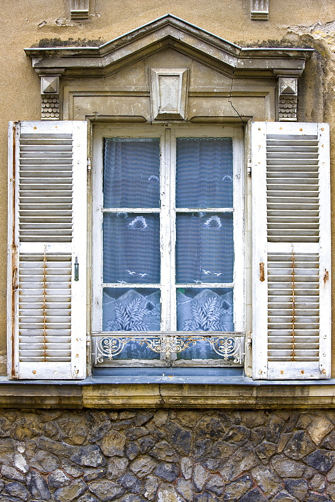 Traditional French window with shutters in Precigne, Pays de la Loire, France