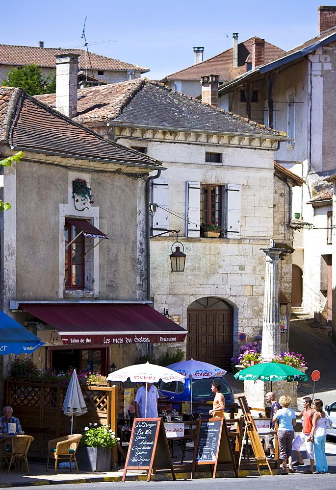 Tourists in quaint town of Bourdeilles popular tourist destination near Brantome in Northern Dordogne, France