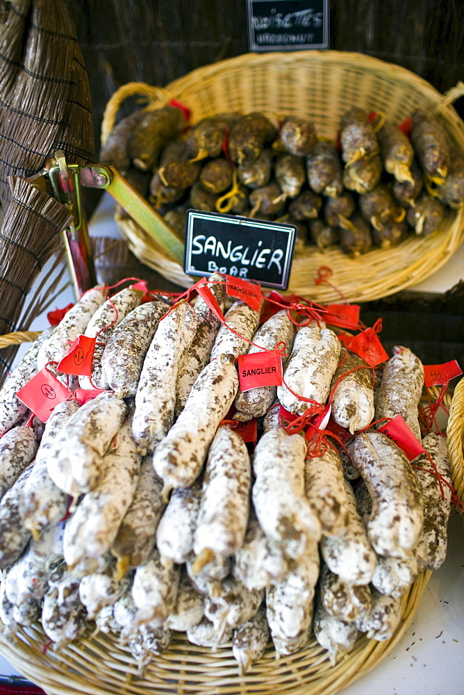 Sanglier boar sausages saucisson on sale in Brantome in North Dordogne, France