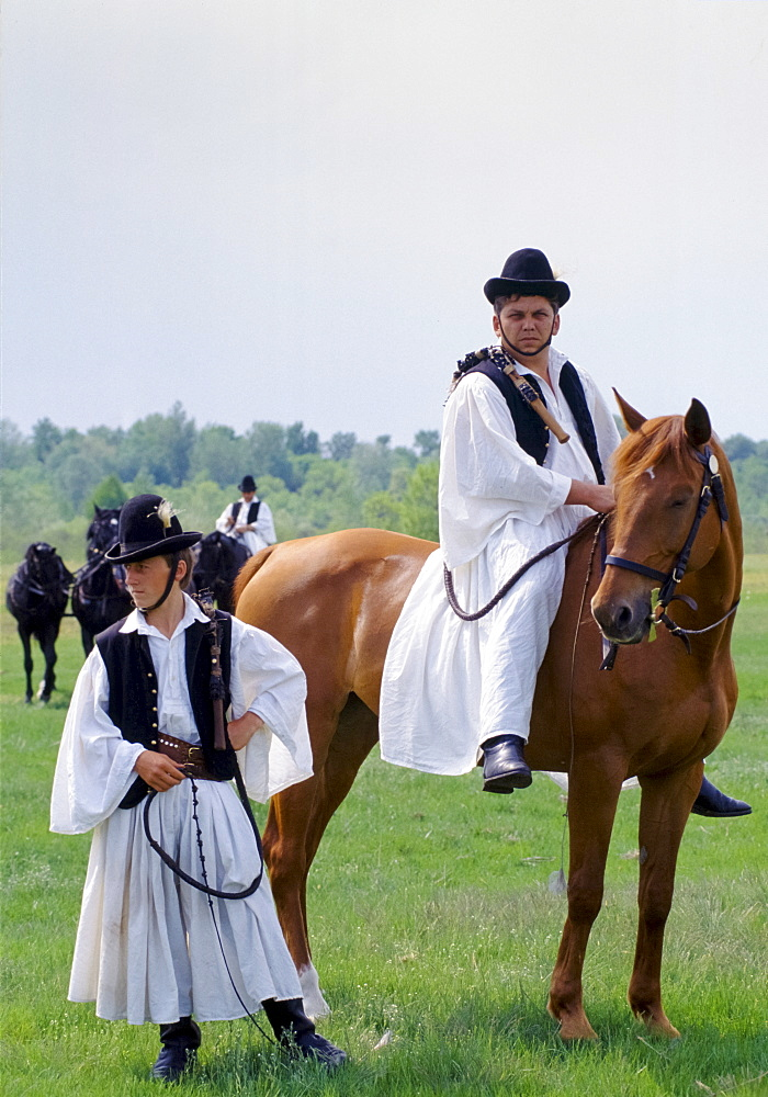 Hungarian Csikos cowboy in traditional costume on The Great Plain of Hungary  at Bugac, Hungary