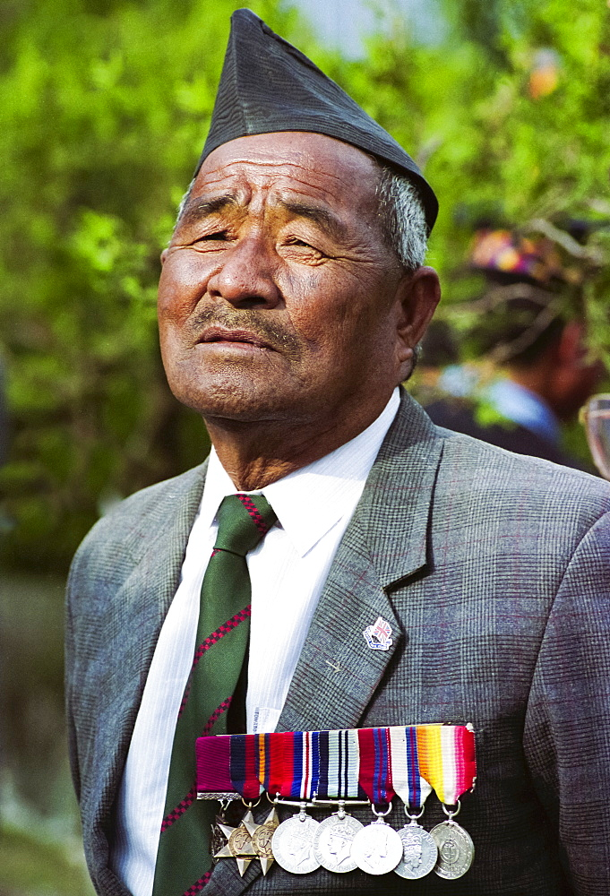 Veteran Ghurka soldier with his war medals proudly displayed in Nepal