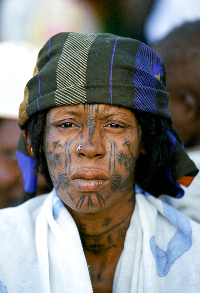 Nigerian local with face markings at tribal gathering cultural event in Nigeria, West Africa