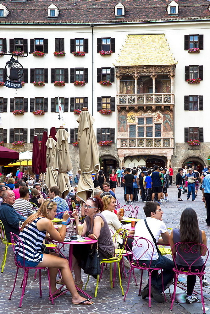 Tourists at Goldenes Dachl (Golden Roof), built in 1500 of gilded copper in Herzog Friedrich Strasse, Innsbruck, the Tyrol, Austria, Europe