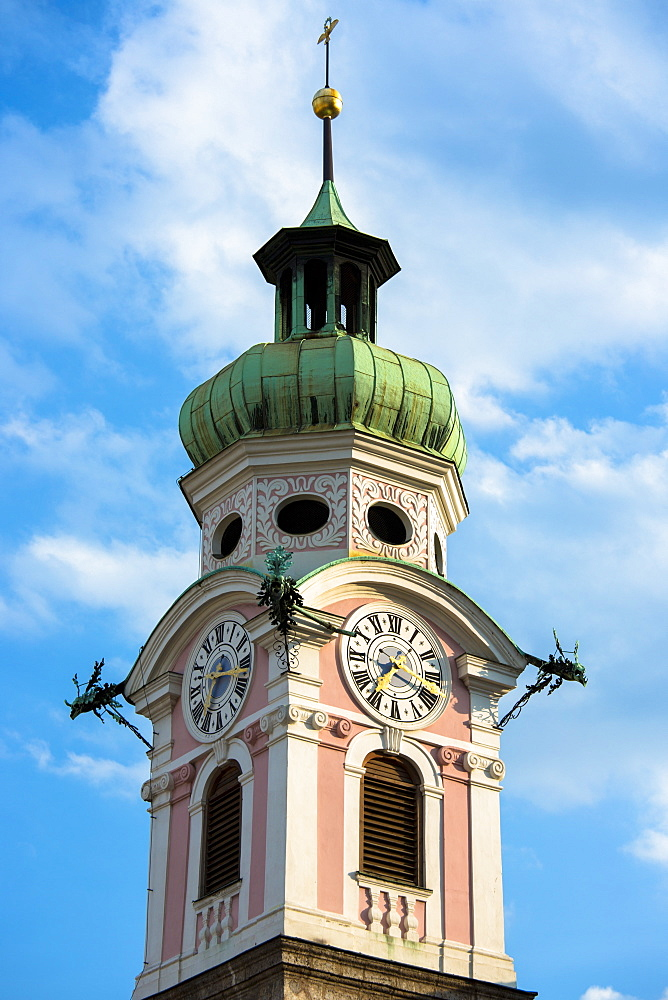 Baroque style 17th century clock tower of Spitalskirche in Maria Theresien Strasse in Innsbruck, the Tyrol, Austria, Europe