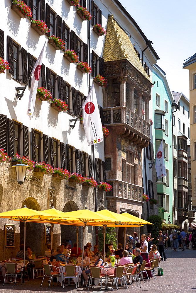 Tourists in pavement cafe in Herzog Friedrich Strasse, Innsbruck the Tyrol, Austria, Europe