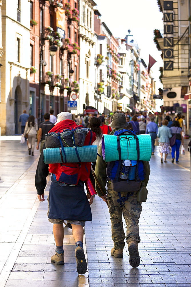 Pilgrims travelling on Camino Santiago reach Calle Ancha in Leon, Castilla y Leon, Spain, Europe