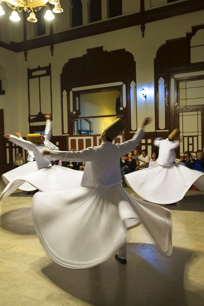 Whirling Dervish dance performance (Mevlevi Sema), a spiritual ceremony performed by whirling dervishes, Istanbul, Turkey, Eurasia