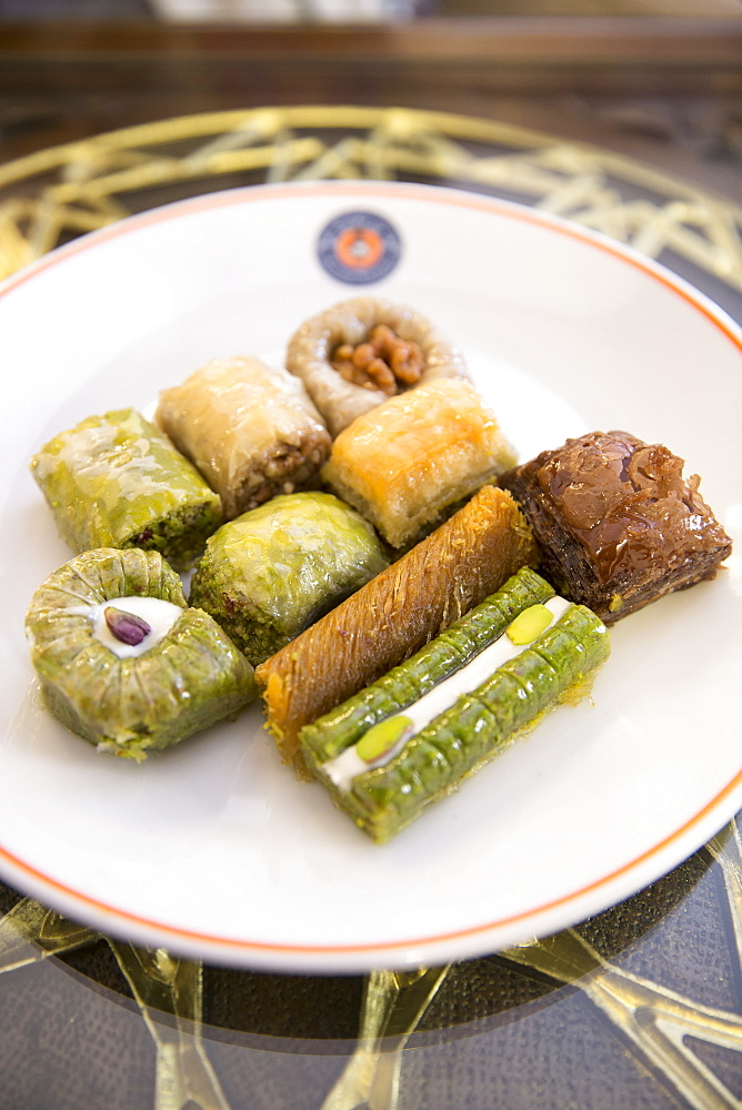 Plate of traditional Turkish honey covered sweetmeats, baklava, dessert of filo pastry and nuts, Istanbul, Turkey, Eurasia