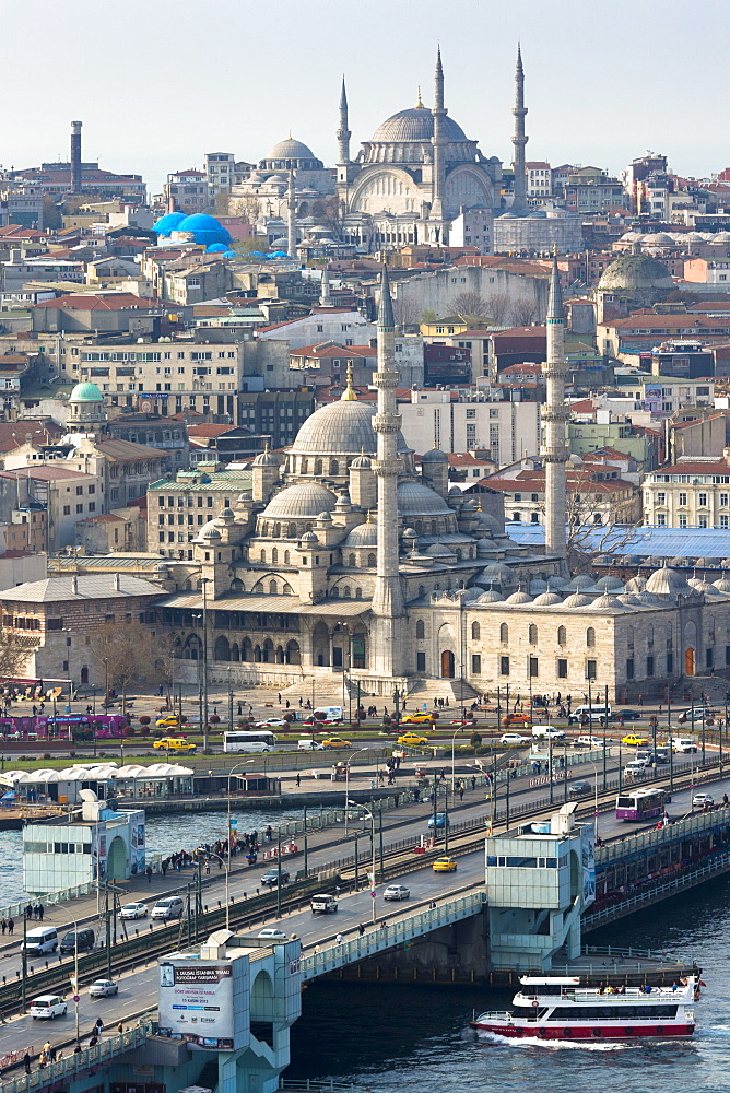Yeni Camii, the Great Mosque, Blue Mosque (behind), Golden Horn, ferry boat on Bosphorus, Istanbul, Turkey, Europe, Eurasia