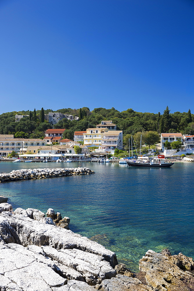 Spectacular beach resort and harbour of Kassiopi with blue sky and turquoise Ionian Sea, Corfu, Ionian Islands, Greek Islands, Greece, Europe - 1161-8656