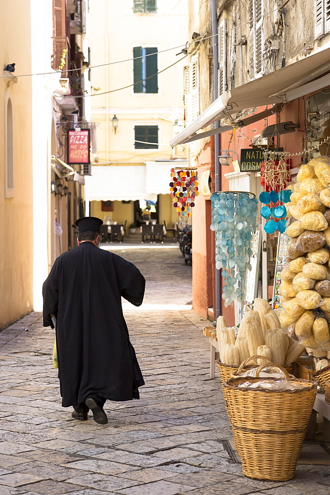 Greek Orthodox priest in traditional robes in street scene in Kerkyra, Corfu Town, Corfu, Greek Islands, Greece, Europe