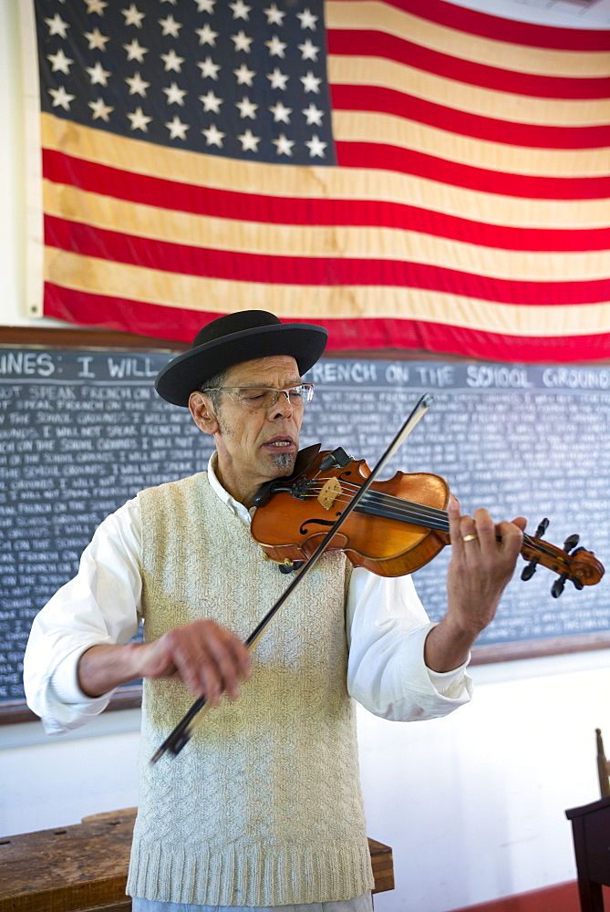 Violinist playing violin at Vermilionville history museum of Acadian, Creole, Native American cultures, Lafayette, Louisiana USA - 1161-8739