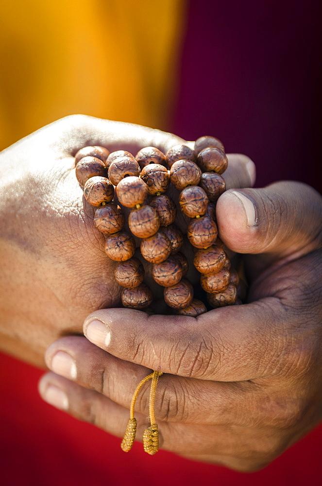 A Buddhist monk holds prayer beads (Japa Mala), Bodhnath, Nepal, Asia  - 1163-101