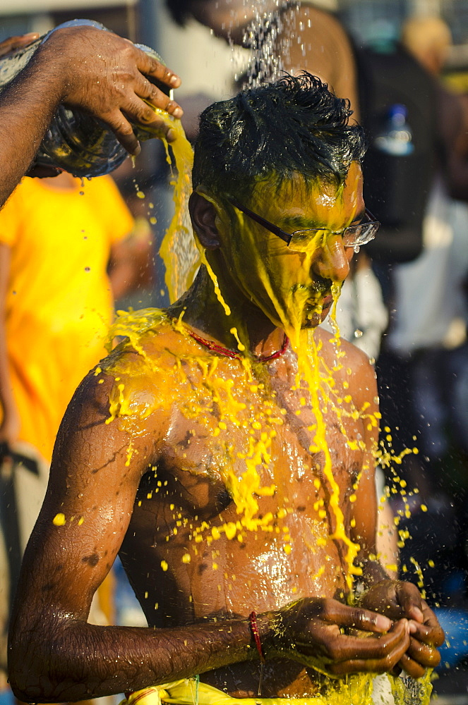 A devotee washes after participating in Thaipusam festival, Batu Caves, Kuala Lumpur, Malaysia, Southeast Asia, Asia