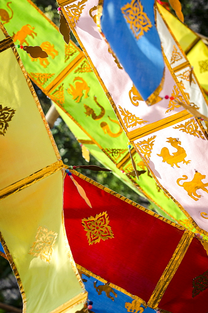 Thai New Year decorations blow in the wind, Wat Chedi Luang, Chiang Mai, Thailand, Southeast Asia, Asia  - 1163-41