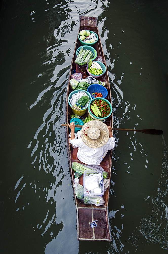 A vendor paddles their boat, Damnoen Saduak Floating Market, Thailand, Southeast Asia, Asia  - 1163-44