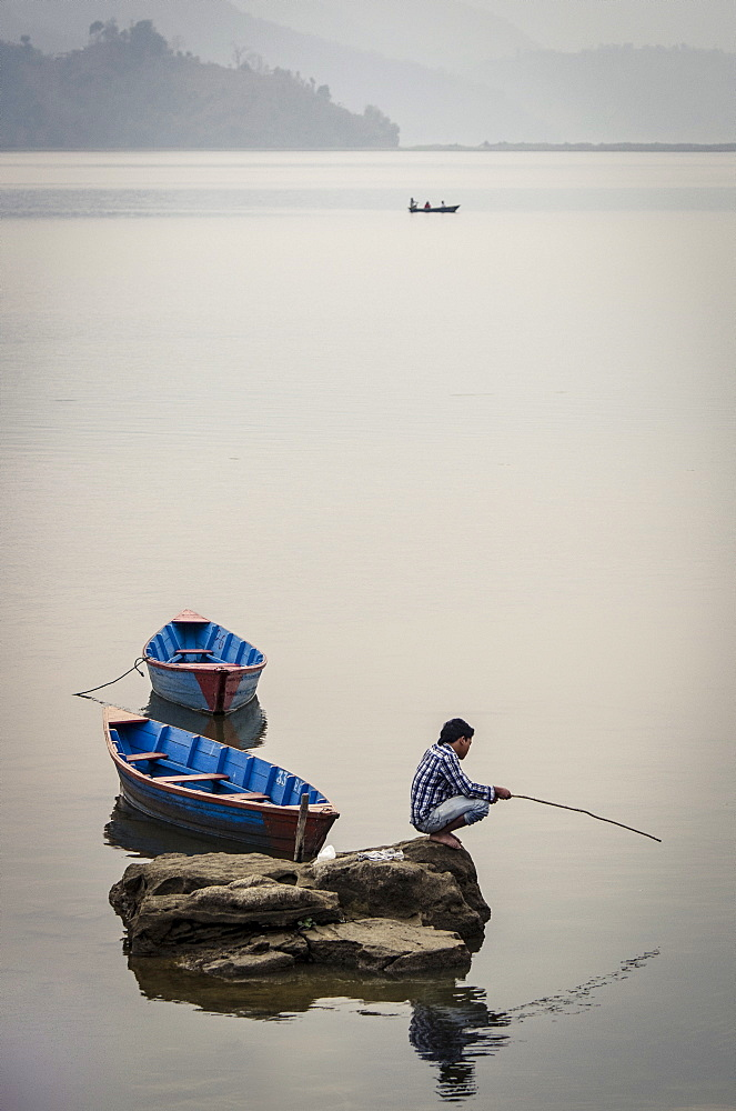 A man fishing on Phewa Tal (Phewa Lake), Pokhara, Nepal, Asia  - 1163-60