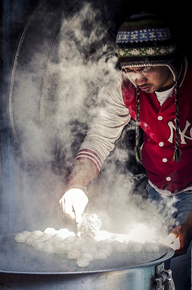 A man steams momos, Bhaktapur, Nepal, Asia - 1163-85