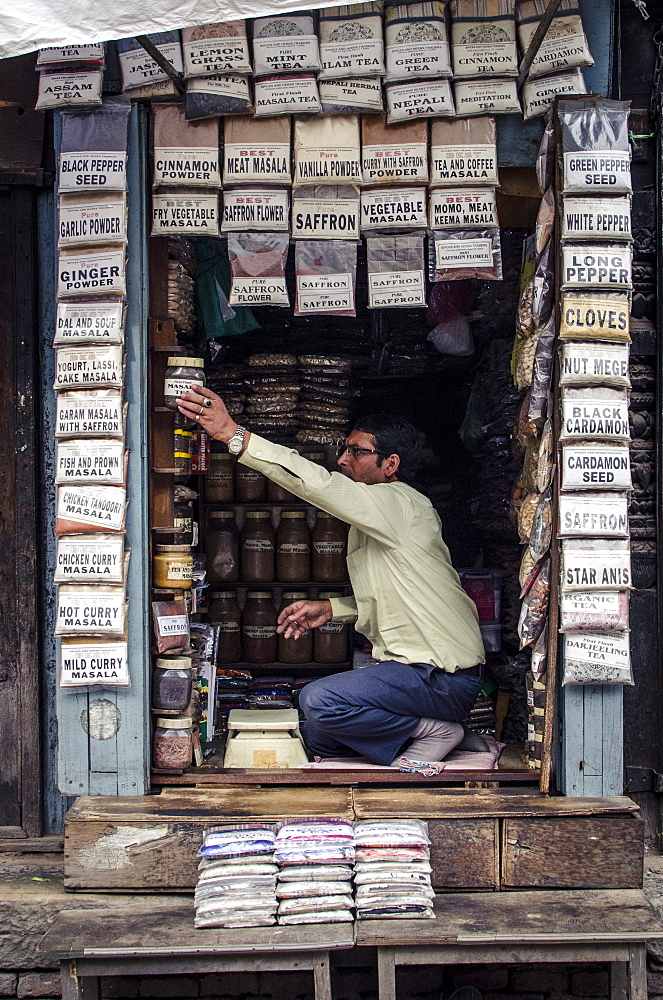 A spice seller arranges his stock, Kathmandu, Nepal, Asia  - 1163-99