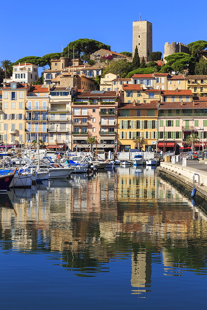 Reflections of boats and Le Suquet, Old (Vieux) port, Cannes, Cote d'Azur, Alpes Maritimes, Provence, France, Mediterranean, Europe