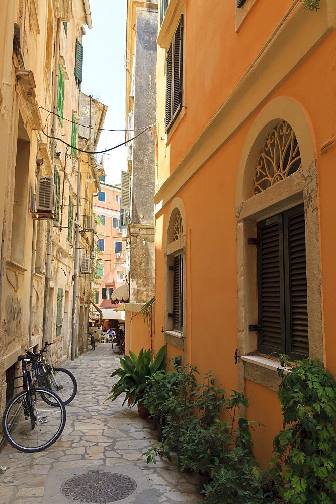 Narrow street with bike, Old Town, Corfu Town, Corfu, Ionian Islands, Greece
