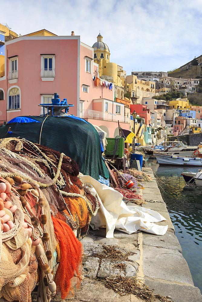 Marina Corricella, pretty fishing village, colourful fishermen's houses, and fishing nets, Procida Island, Bay of Naples, Campania, Italy, Europe