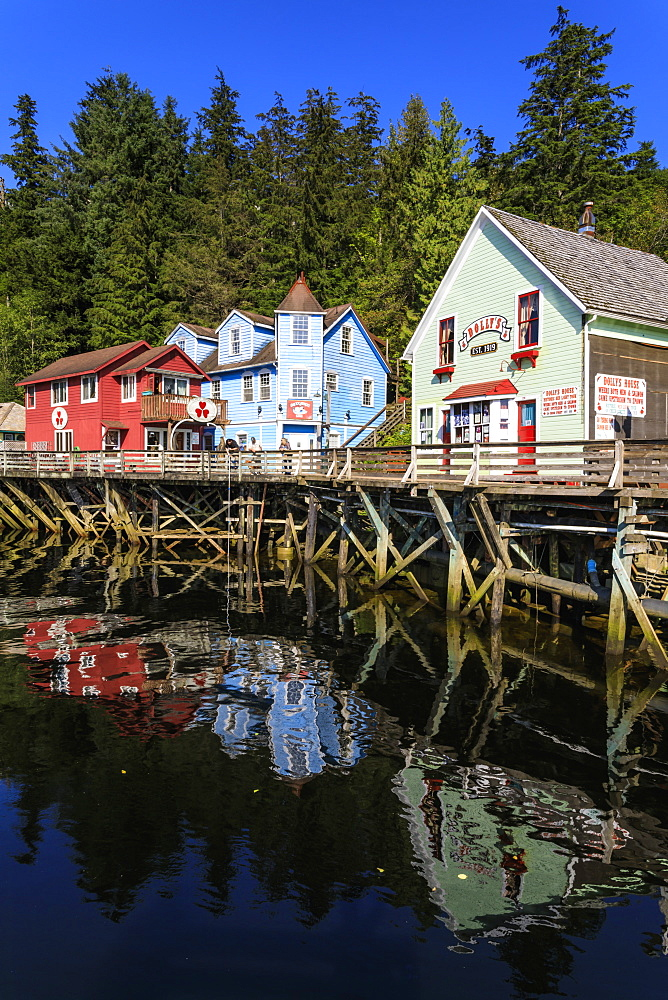 Creek Street, Ketchikan Creek boardwalk reflections, historic red-light district, beautiful sunny day, Ketchikan, Alaska, United States of America, North America