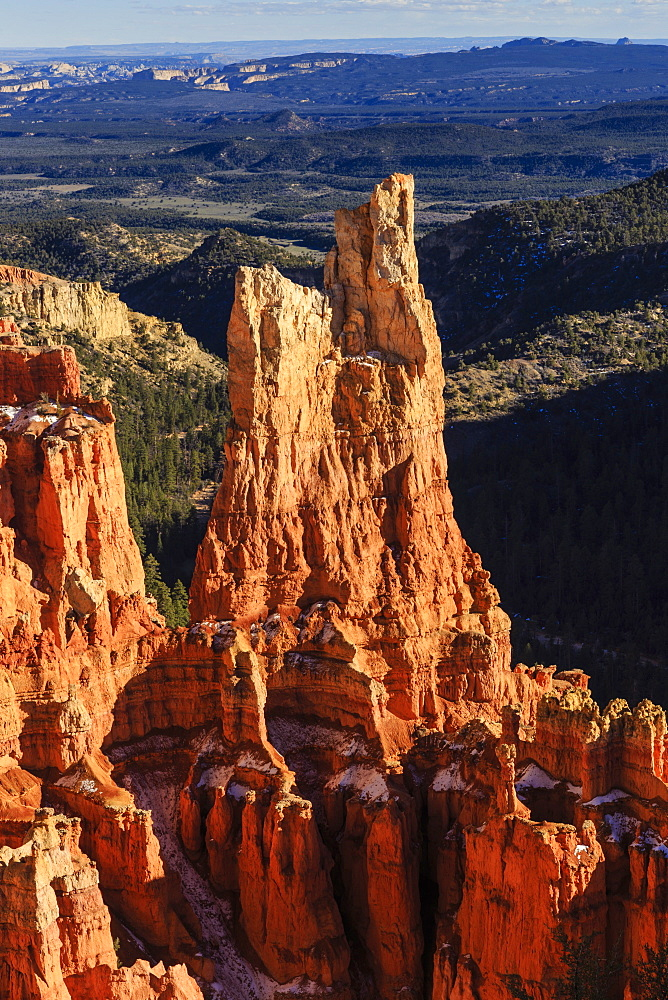 Hoodoos lit by late afternoon sun with distant view in winter, Paria View, Bryce Canyon National Park, Utah, United States of America, North America