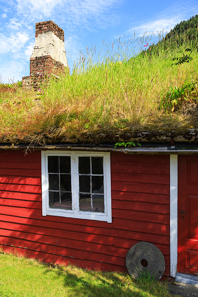 Turf roof, wooden red cottage, Haereid mountain plateau, sunny day, beautiful Eidfjord, Norwegian Western Fjords, Norway, Europe