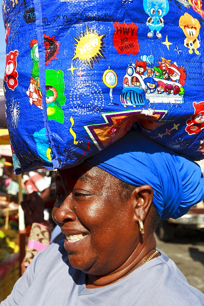 Lady with shopping bag on head, market, Roseau, Dominica, West Indies, Caribbean, Central America